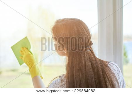 Woman Cleaning A Window. Person Wiping Glass With Rag. Tips For Housewives.