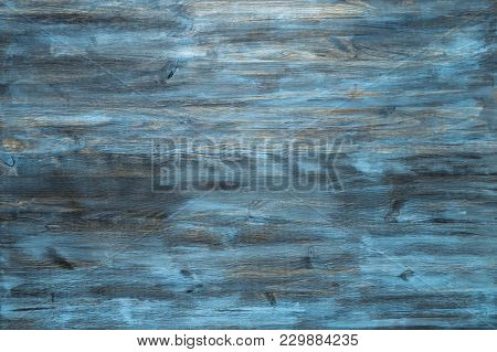Blue Stained Wood Texture Background With A Worn Distressed Effect. Use This Weathered Wooden Textur