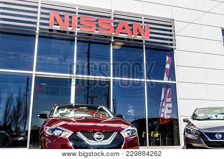 Indianapolis - Circa March 2018: Logo and Signage of a Nissan Car and SUV Dealership. Nissan is part of the Renault-Nissan Alliance I