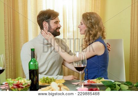 Beautiful Couple At Dinner Table. Young Man And Woman Smiling. Interesting Facts About Dating.