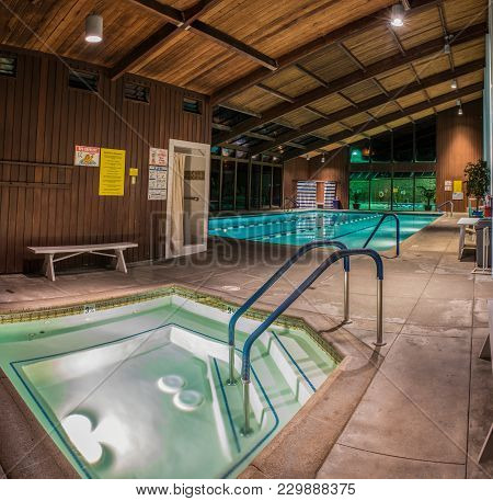 Jacuzzi, Therapy Pool, And Further Back, The Lap Pool Of The Pierpont Racquet Club Under Morning Lig