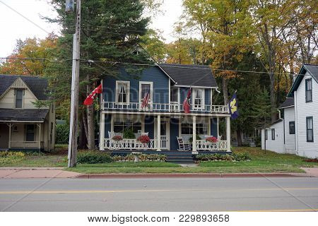 Bay View, Michigan / United States - October 16, 2017:  A Two Story Victorian Cottage, With A Balcon