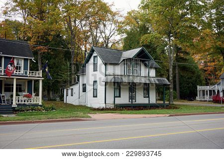 Bay View, Michigan / United States - October 16, 2017:  A Two Story White Victorian Cottage, With A