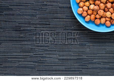 Hazelnut In Blue Plate On Dark Background. Hazel Nut For Food. Organic Food Banner Template With Tex