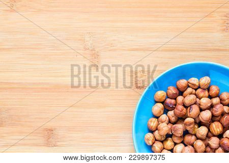 Hazelnut In Blue Plate On Wooden Background. Hazel Nut For Food. Organic Food Rustic Banner Template