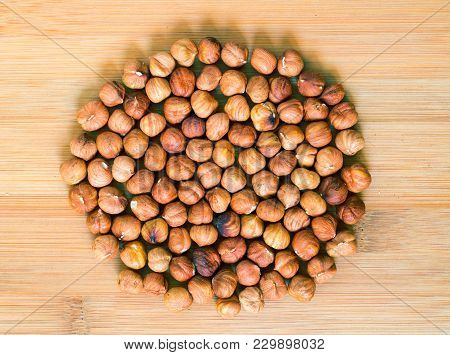 Hazelnut Circle On Wood Background. Ripe Hazel Nut For Food. Organic Food Rustic Banner Template Wit