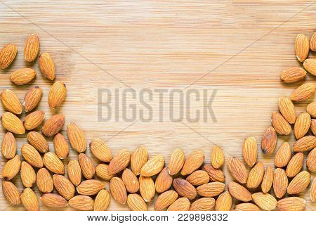 Almond Border On Wooden Background. Ripe Almond Nut For Food. Organic Food Rustic Banner Template Wi