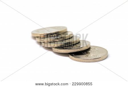 Silver Metallic Coins. Cash Money Closeup Photo. Currency Background. Business Success And Profit Co