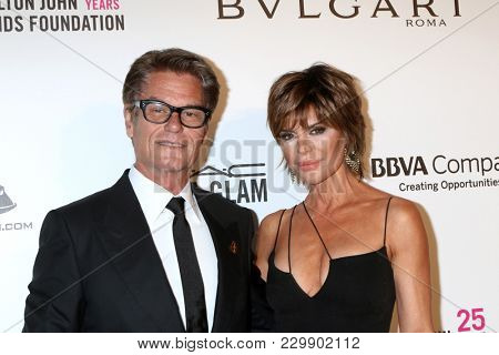 LOS ANGELES - MAR 4:  Harry Hamlin, Lisa Rinna at the 2018 Elton John AIDS Foundation Oscar Viewing Party at the West Hollywood Park on March 4, 2018 in West Hollywood, CA