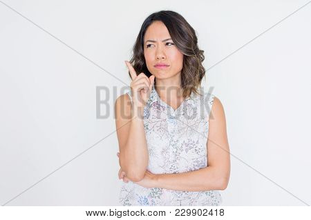 Pensive Asian Woman Thinking Over New Idea And Raising Finger Up. Young Business Woman Pointing At S