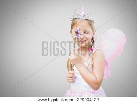 Digital composite of Girl against grey background with fairy princess costume