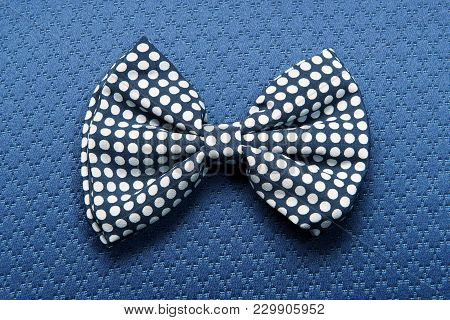 Dotted Bow-tie On Blue Background