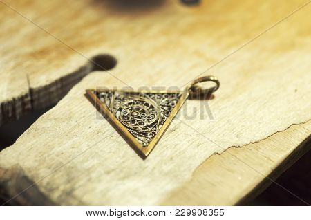 The Work Of Jewelers. Trial Jewelry Of Semiprecious Metals. Triangular Brooch With A Braided Pattern