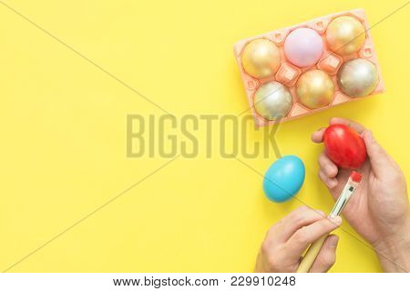 Top View Person Painting Colorful Easter Egg Painted In Pastel Colors Composition With Paint Brush O