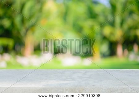 Stone Board Empty Table In Front Of Blurred Background. Perspective Gray Stone Over Blur Trees In Fo