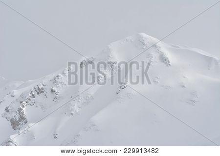 Mountain Peak Covered With Snow. Oslea Peak