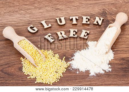 Inscription Gluten Free With Heap Of Millet Groats And Flour On Wooden Scoop, Concept Of Healthy Foo