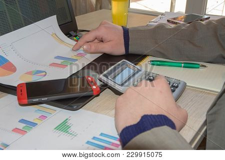 Businessman Using A Calculator To Calculate The Numbers. Accounting , Accountancy, Calculation Conce