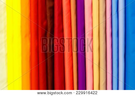 Wide Selection Of Different Color Textile Silk Fabrics Clothes Lay In Row In Drapery Store