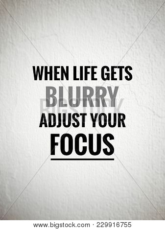 poster of Motivational and inspirational quotes - When life gets blurry, adjust your focus. With blurred vintage styled background.