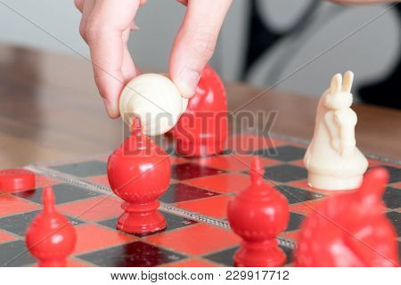 the white chess on women hand is fighting with red, think, discuss, committed, competition, winner, successful, dedicate concept poster