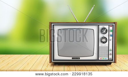 Vintage Tv Box On Wooden Table On Background Of Nature. 3d Render