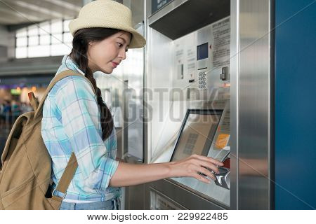 Young Woman Using Smartphone Wallet To Pay