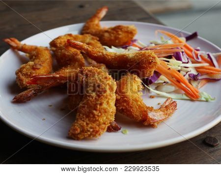 Deep Fried Prawn In Breading Close Up Photo On The Wooden Table
