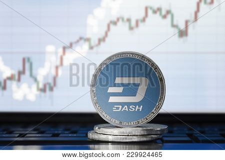 Dash Cryptocurrency; Physical Concept Dash Coin On The Background Of The Chart