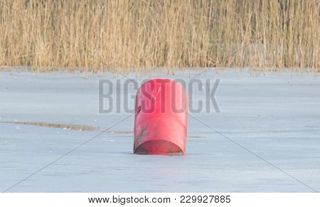 Red Buoy In A Large Pond
