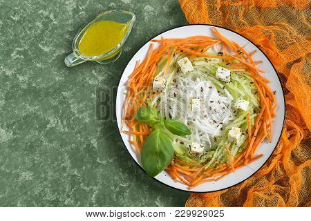 Vitamin Salad From Carrots, Daikon And Green Radishes With Cheese, Vinaigrette Sauce And Flaxseed. D