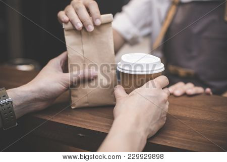 Hand Of Barista Making Service To Customer In The Coffee Shop. People With Barista In Cafe Concept.