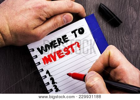 Handwritten Text Sign Showing Where To Invest Question. Conceptual Photo Financial Income Investing