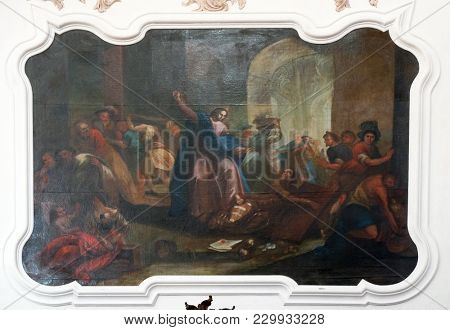 AMORBACH, GERMANY - JULY 08: Christ Driving the Money Changers from the Temple, fresco in Benedictine monastery church in Amorbach, Germany on July 08, 2017.