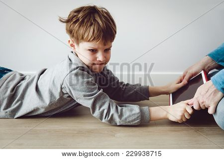Computer Addiction- Father Taking Touch Pad From Angry Upset Child