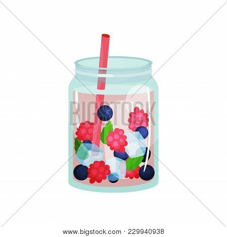 Delicious Detox Water With Raspberry, Blueberry, Ice Cubes And Pink Straw. Delicious Refreshing Drin