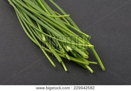Colorful And Crisp Image Of Chives On Black Background