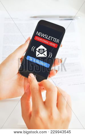 Subscribe To Newsletter With Mobile Phone With Woman Hand Touching Smartphone