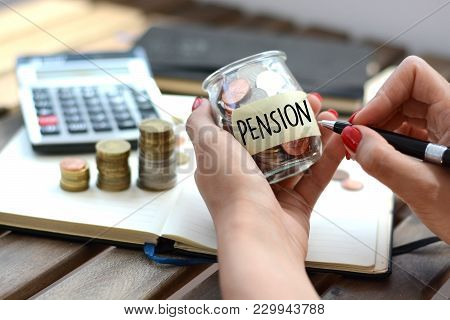 Pension Fund Label Stuck On A Glass Jar Filled With Coins