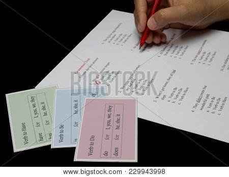 English Grammar Test Sheet On Black Table