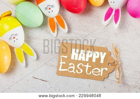 Easter Scene With Colorful Eggs And Bunnies, Top View With Happy Easer Greetings