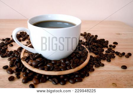 Coffee In White Cup On Wooden Table In Coffee Shop