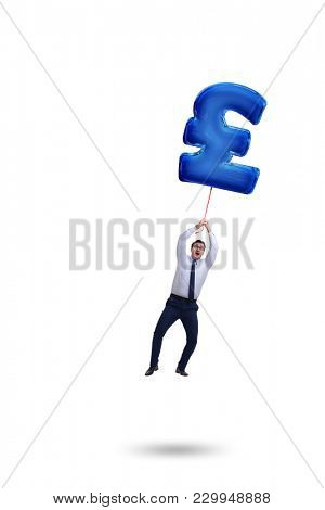 Businessman flying on british pound sign inflatable balloon