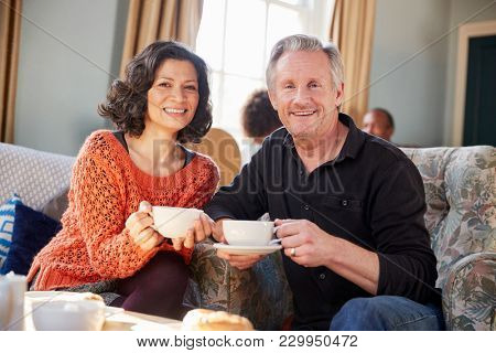 Portrait Of Middle Aged Couple Meeting In Coffee Shop