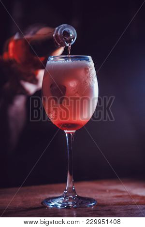 alcohol drink with strawberry on bar. cocktail