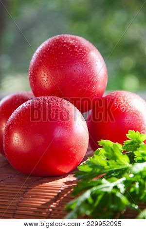 beautiful ripened tomatoes. rustic still life
