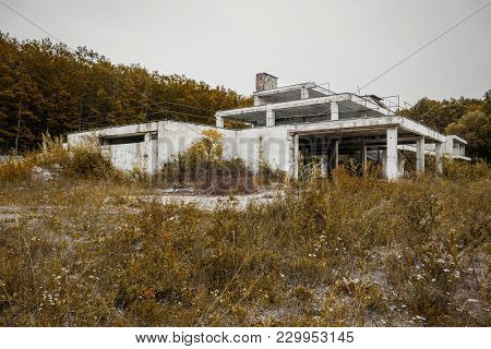 Old Abandoned And Burned Hotel After Fire,  Which Was 25 Years Ago. Urbex Photo Of Scary Abandoned W