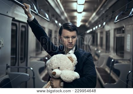 Guy With A Teddy Bear In The Subway. In An Empty Car He Is Lonely, It Makes Him Sad.