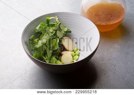 Fresh Prepared Vegetables Soup Ingredients With Broth