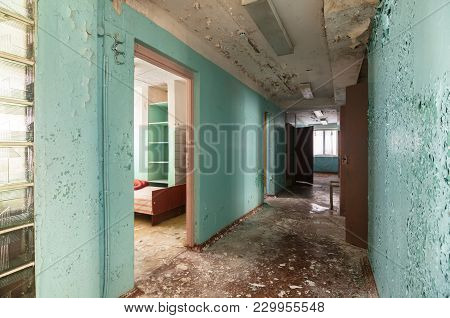 Corridor With Open Doors In An Abandoned Building Of A The Children's Pioneer Camp